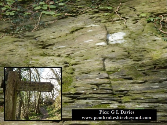 The Pilgrims cross, Nevern. This is not simply a carving on stone but a marker on a cave that has been bricked up. What do you think is behind the wall?